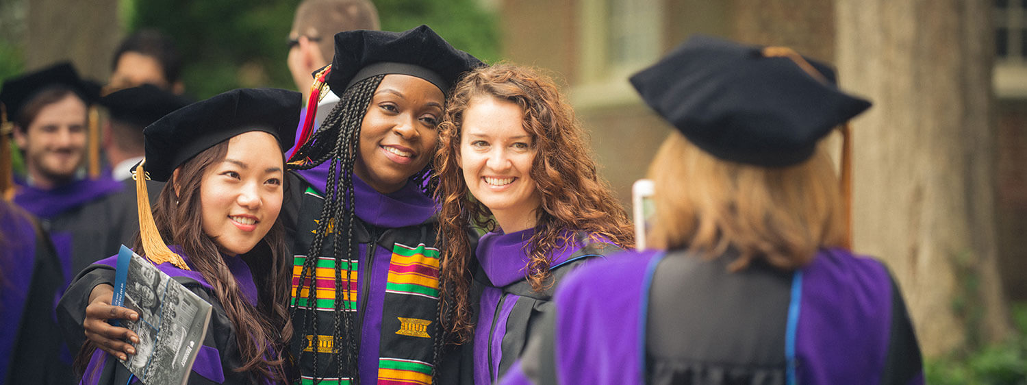 Graduates pose for photographs during a commencement ceremony of Regent University, which believes in developing Christian leaders who will impact the world.