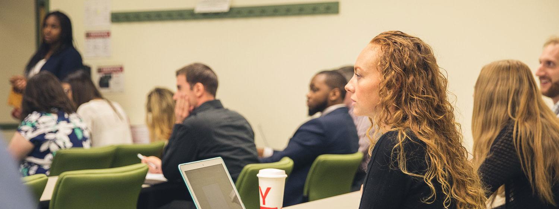 Students listen during a class at Regent University, Virginia Beach.