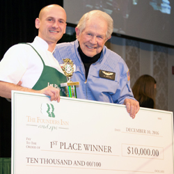 "Dr. M.G. ""Pat"" Robertson with the top Holiday Bakeaway contestant."
