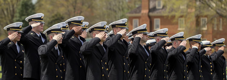 Military personnel salute at Regent University, Virginia Beach.