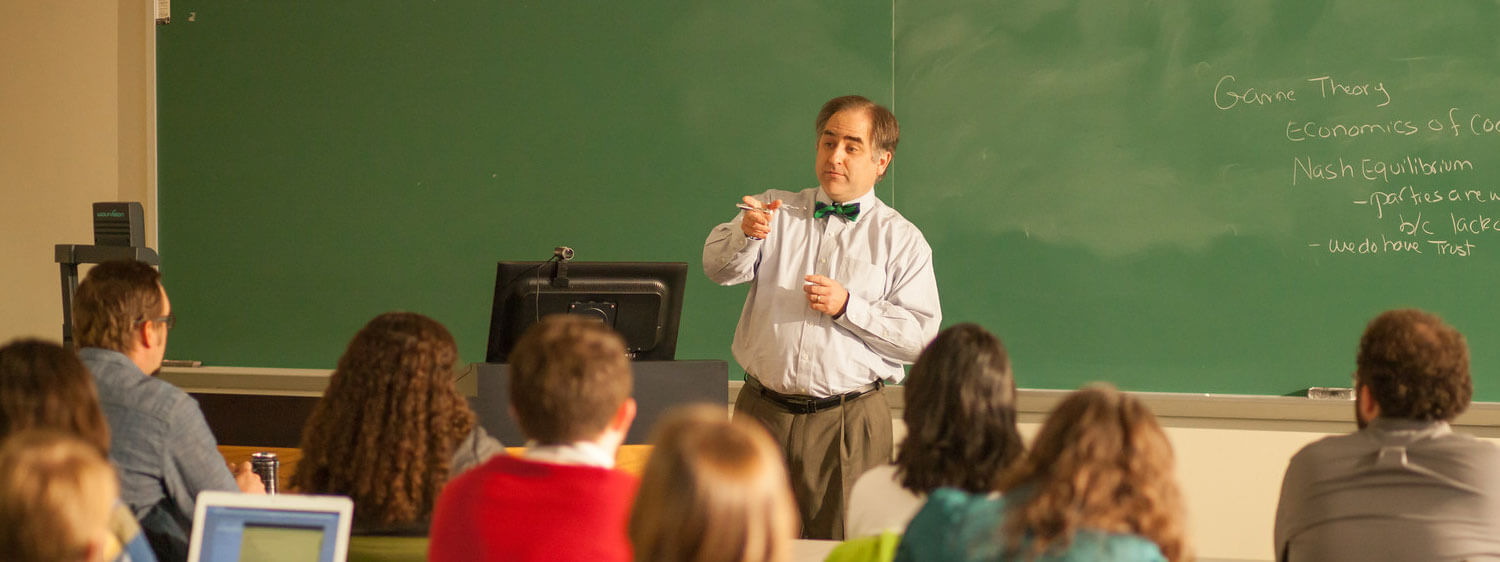 Brian Baugus, Assistant Professor of Business, Leadership and Management at Regent University, teaches a class.