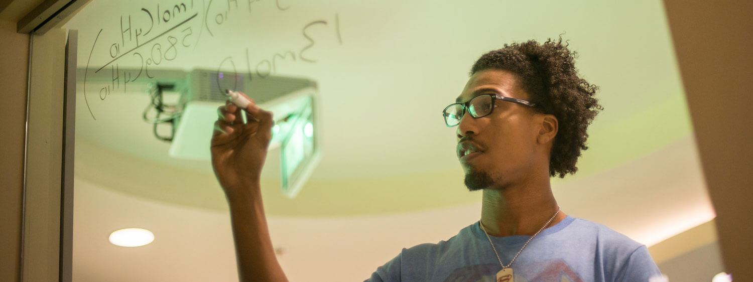 A student performs a calculation at Regent, a premier Christian university with high-ranking undergraduate degree programs.