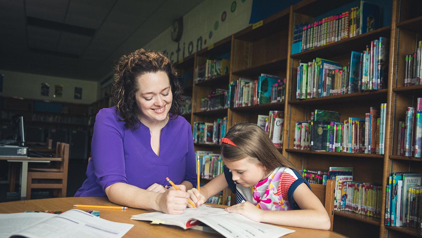 A alumnus of Regent University's School of Education teaches a student.
