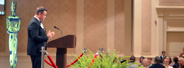 Professor Don Finn, Dean of Regent University's School of Education, speaks at an event.