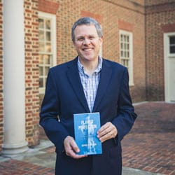 Dr. Jeffrey Brauch, with his book 'Flawed Perfection: What It Means To Be Human & Why It Matters For Culture, Politics, And Law.'