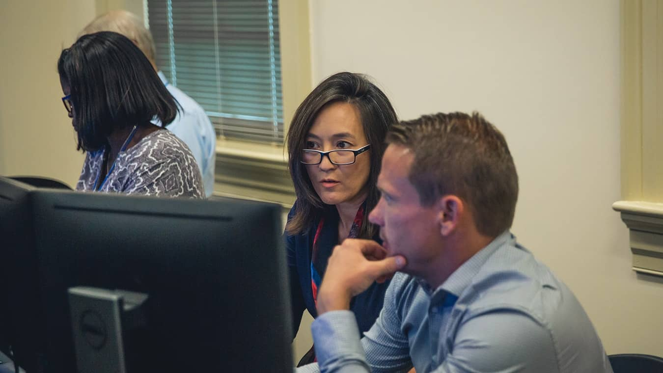 Individuals at the cyber lab: Explore Regent's online master's in psychology - cyberpsychology program.