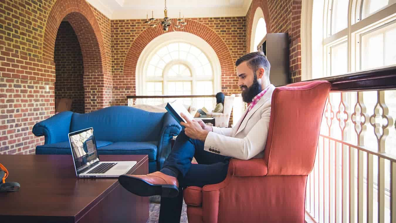 A graduate at the library: Pursue a Master of Business Administration (MBA) in Innovation Management at Regent University.
