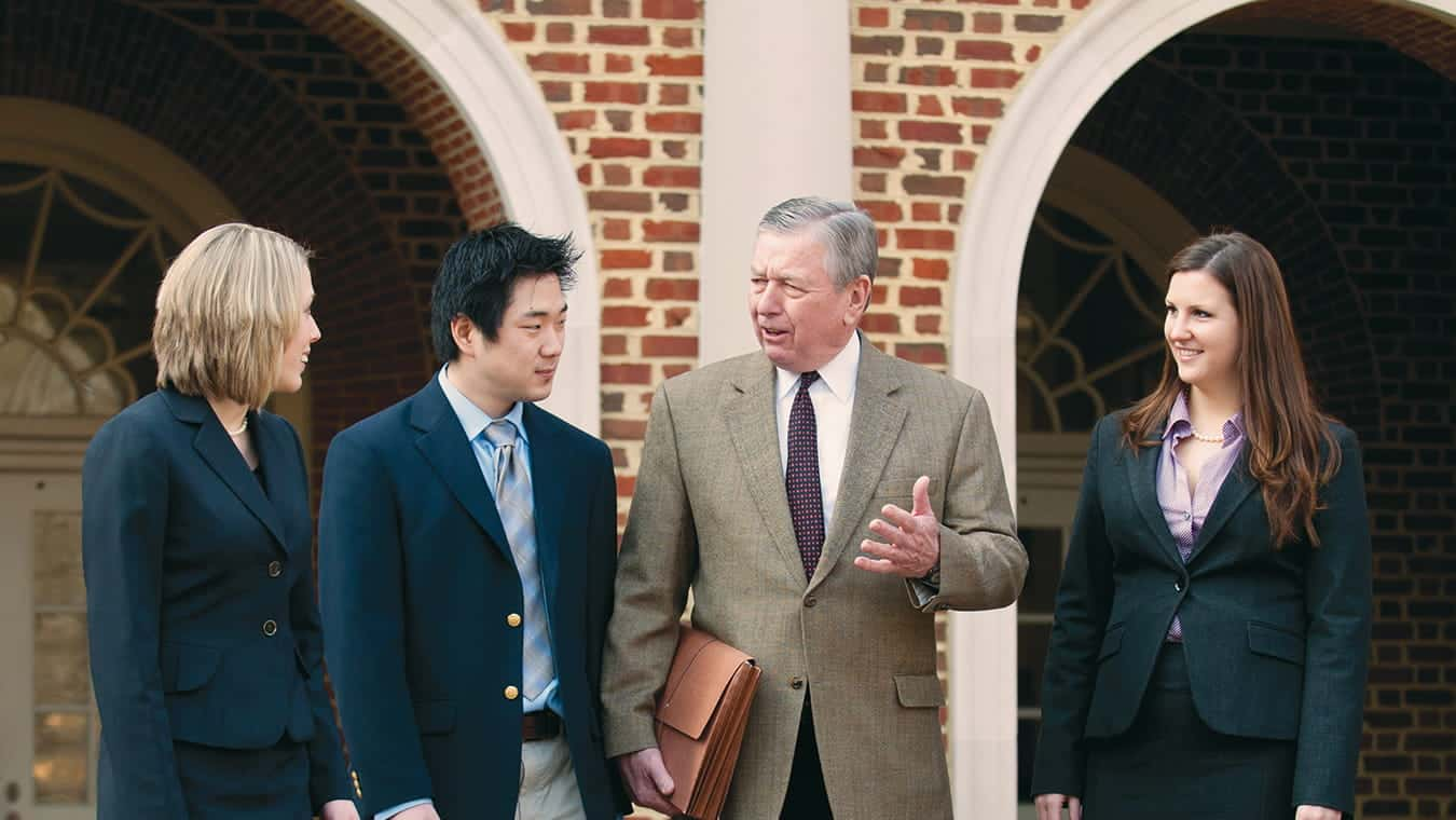 Distinguished Professor John Ashcroft with students: Explore the Certificate in the Law and Higher Education offered by Regent University.