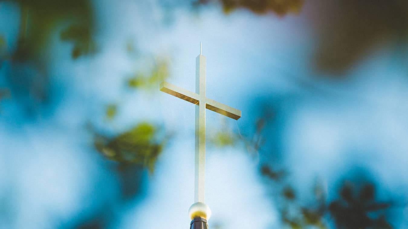 The Cross on Regent's chapel steeple: Pursue a Certificate of Graduate Studies: Divinity/Theology at Regent University, online or in VA.