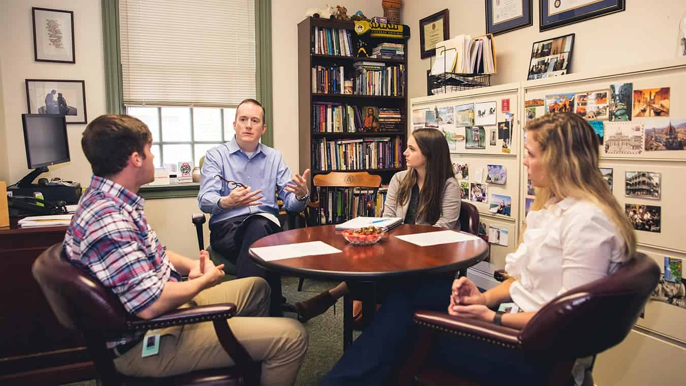 A group being taught: Explore Regent's online MA in Human Services - Addictions Counseling program.