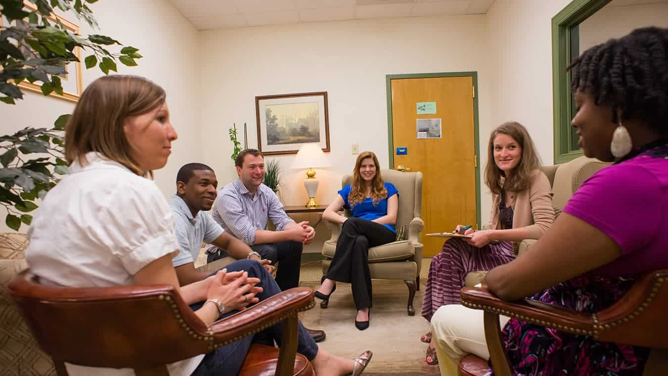 A group interacting: Explore Regent's online MA in Human Services - Human Services for Student Affairs program.