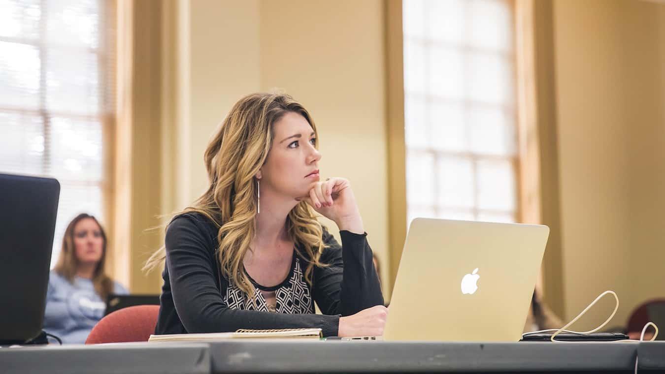 A student in class: Pursue the Master of Arts in Organizational Leadership (MAOL) in Interdisciplinary Studies degree at Regent University.