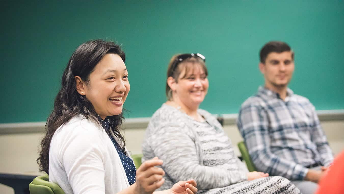 Students in a class: Explore Regent's online master's in psychology - addictions program.
