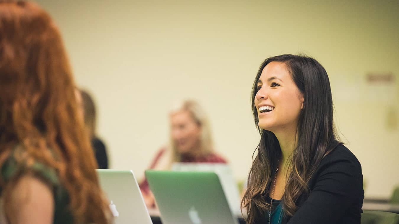 Students in a class: Explore Regent's online master's in psychology – marriage and family program.