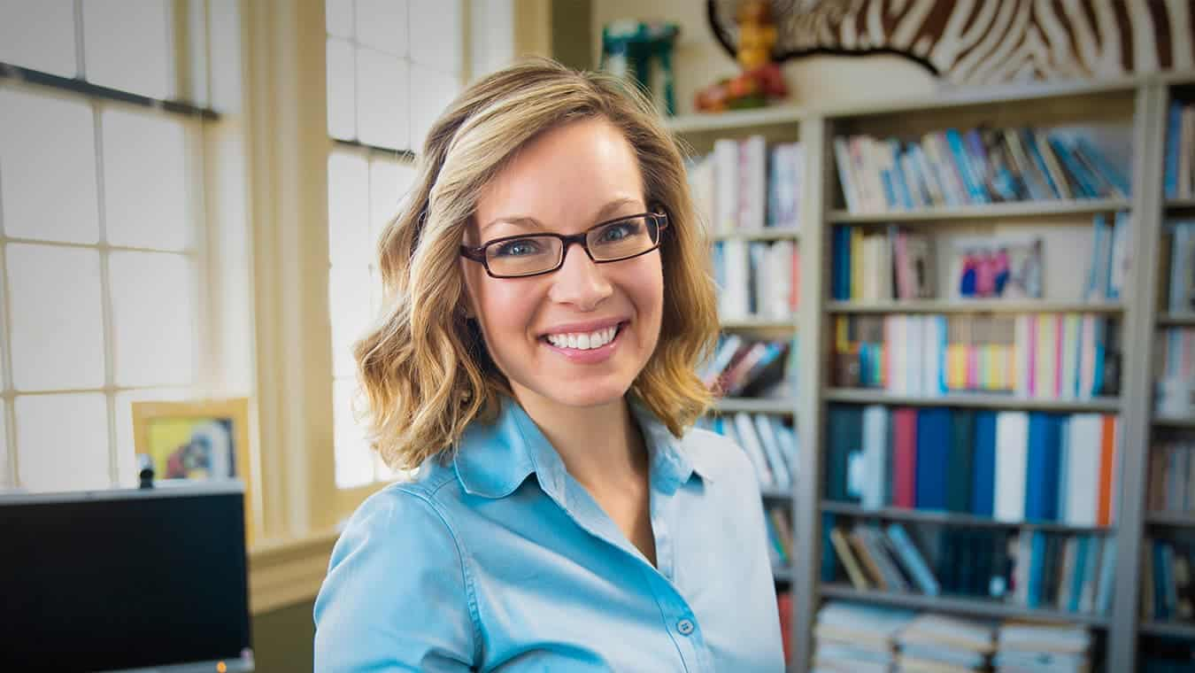 A lady in an office: Explore the Certificate in Christian Education offered by Regent University, Virginia Beach.