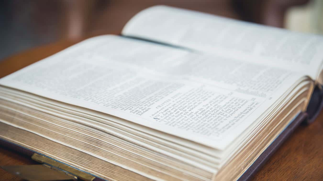An open Bible: Explore the PhD in Theology online program at Regent University.