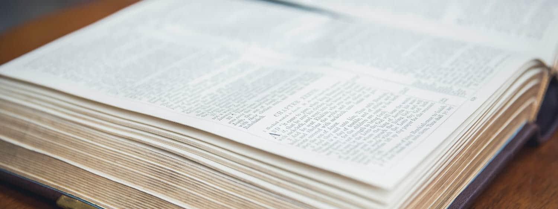 An open Bible: Pursue an MDiv Old Testament online or on campus at Regent University, Virginia Beach, VA 23464.