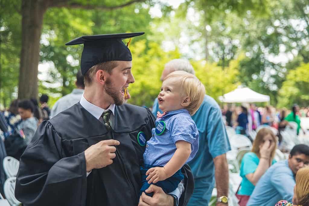 A Regent University graduate with his son.