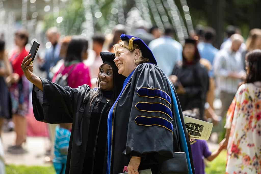 Celebrating friendship during Regent University's commencement ceremony.