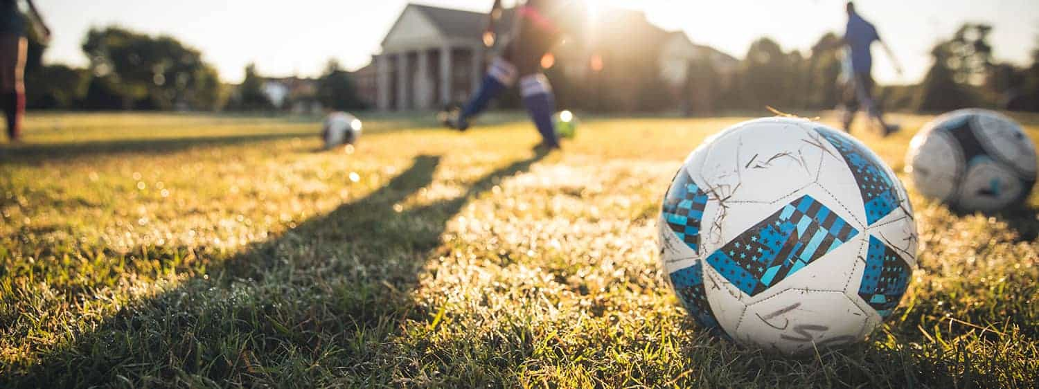 A soccer game on campus: Pursue a Sports Management program at Regent University.