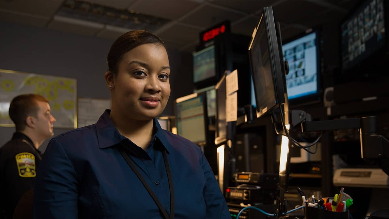 A lady in a dispatch center: Regent University offers a criminal justice minor online and in Virginia Beach, VA 23464.
