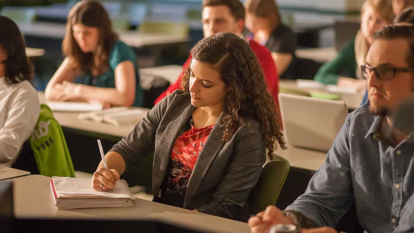 Students in a classroom: Regent University offers an international relations minor online and in Virginia Beach, VA 23464.