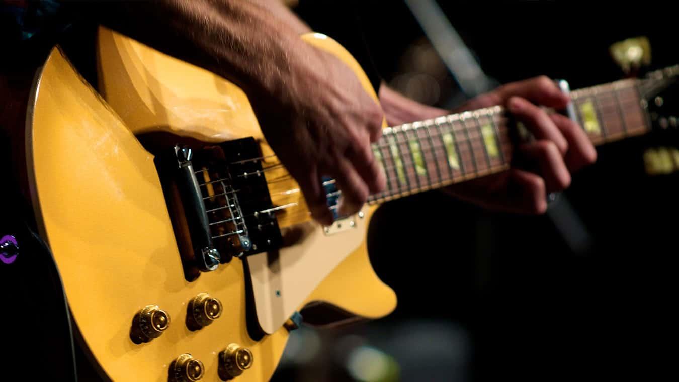 A guitar being strummed: Regent University offers a music minor on campus in Virginia Beach, VA 23464.