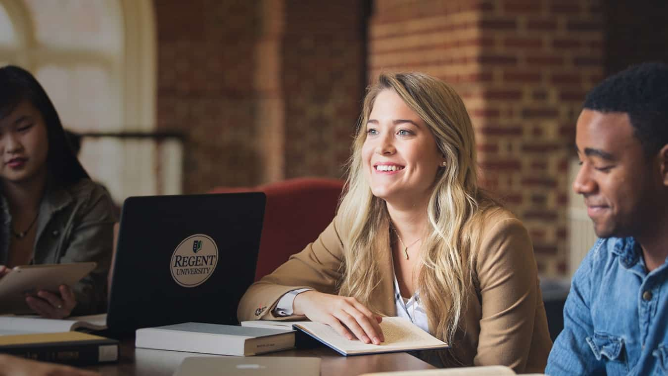 Graduates at the library: Regent University offers a political philosophy minor online and in Virginia Beach, VA 23464.
