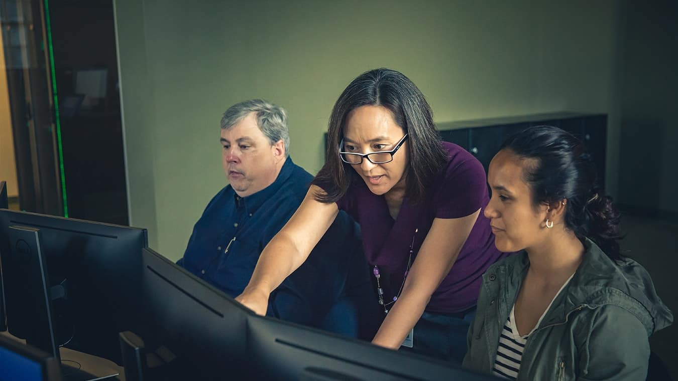 A professor teaching a student: Pursue your B.S. in Computer Engineering degree online at Regent University.