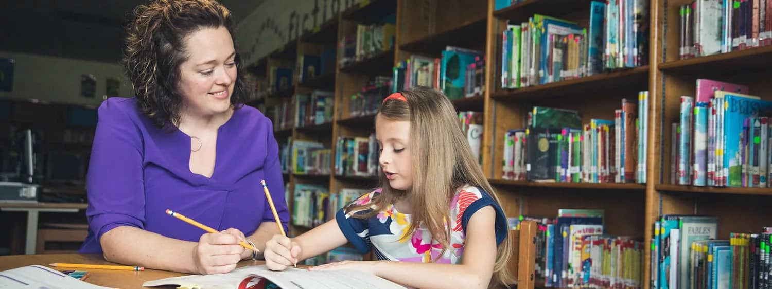 An alumna with a student: Pursue your B.S. in Early Childhood Education degree online at Regent University, Virginia Beach.
