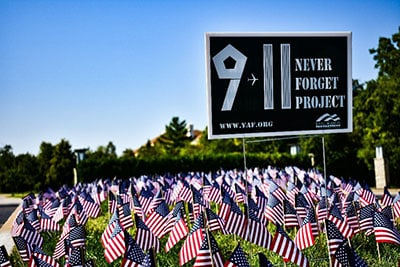 Regent University students honor victims of 9 11 with flags for each victim.