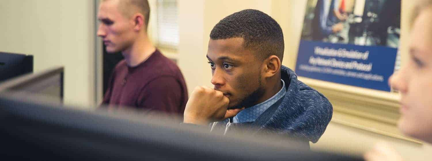 Students in a classroom: Pursue a B.S. in cybersecurity degree online or on campus at Regent University, Virginia Beach, VA 23464.