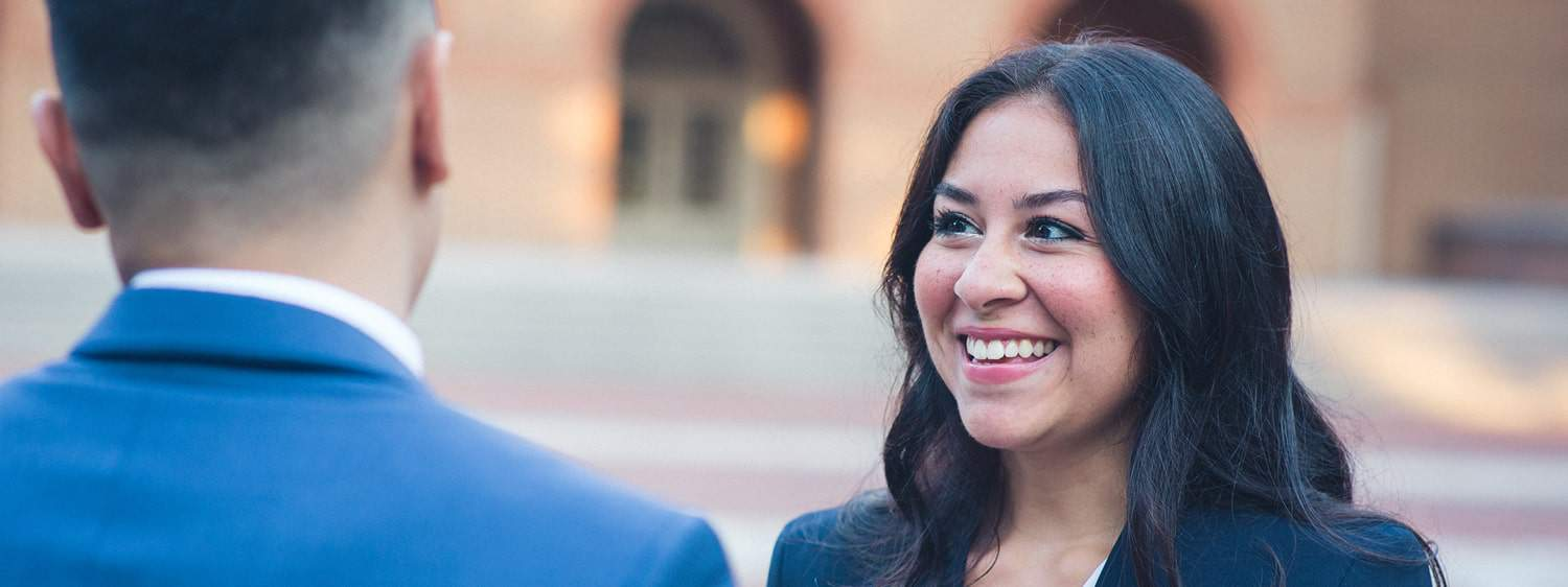 Two graduates on campus: Regent offers a B.S. in Business - Marketing program online and in Virginia Beach, VA 23464.