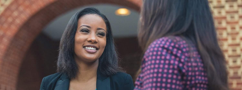 Two ladies on campus: Pursue Regent's B.S. in Business - Human Resources program online or in Virginia Beach, VA 23464.