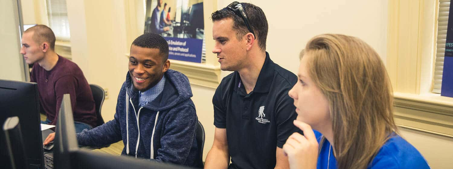 Students in a classroom: Pursue a B.S. in Computer Science degree program at Regent University.