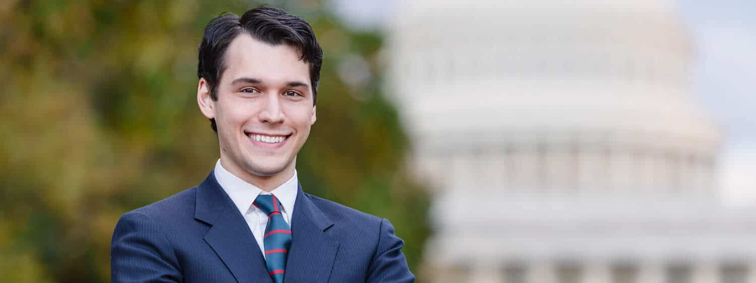 A person in front of the Capitol: Explore the online campaign management and political leadership program at Regent.