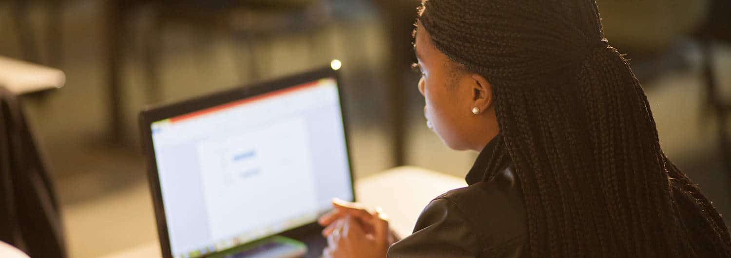 A student studying online.