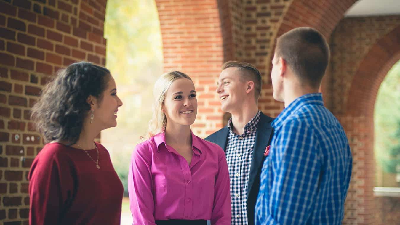 A group of graduates: Explore the minor in business offered by Regent University.