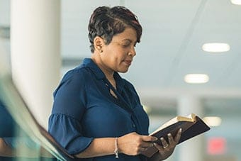 A lady looks at a Bible at a church in Virginia Beach.