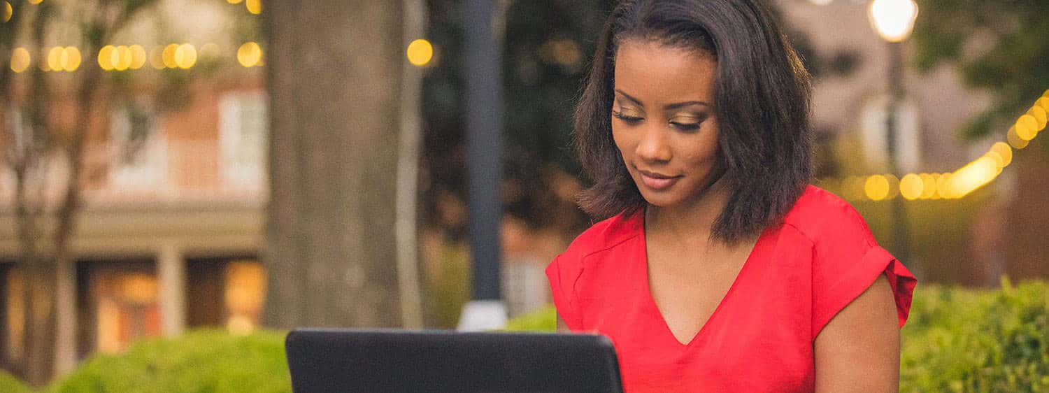 A student looks at her laptop at Regent, a premier Christian university that offers a SuccessPath Scholarship.