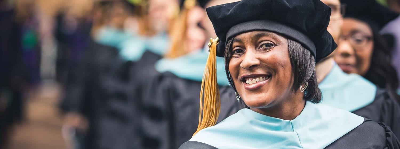 A graduate of Regent University's education school during its graduation ceremony in Virginia Beach.