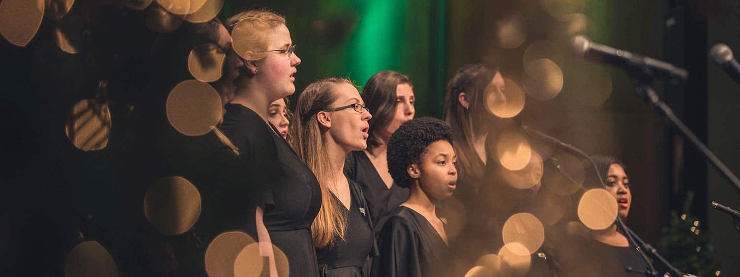 A Regent University choir performing at a Christmas concert held on campus in Virginia Beach, VA 23464.