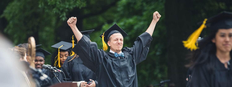 A graduate exults during Regent University's commencement ceremony in Virginia Beach, VA 23464.