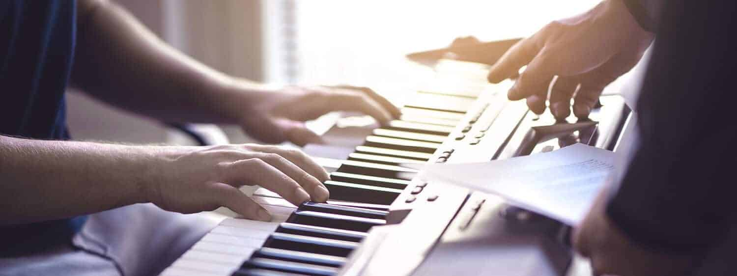 Making music on a keyboard; Explore Regent's B.M. in Church Music degree.