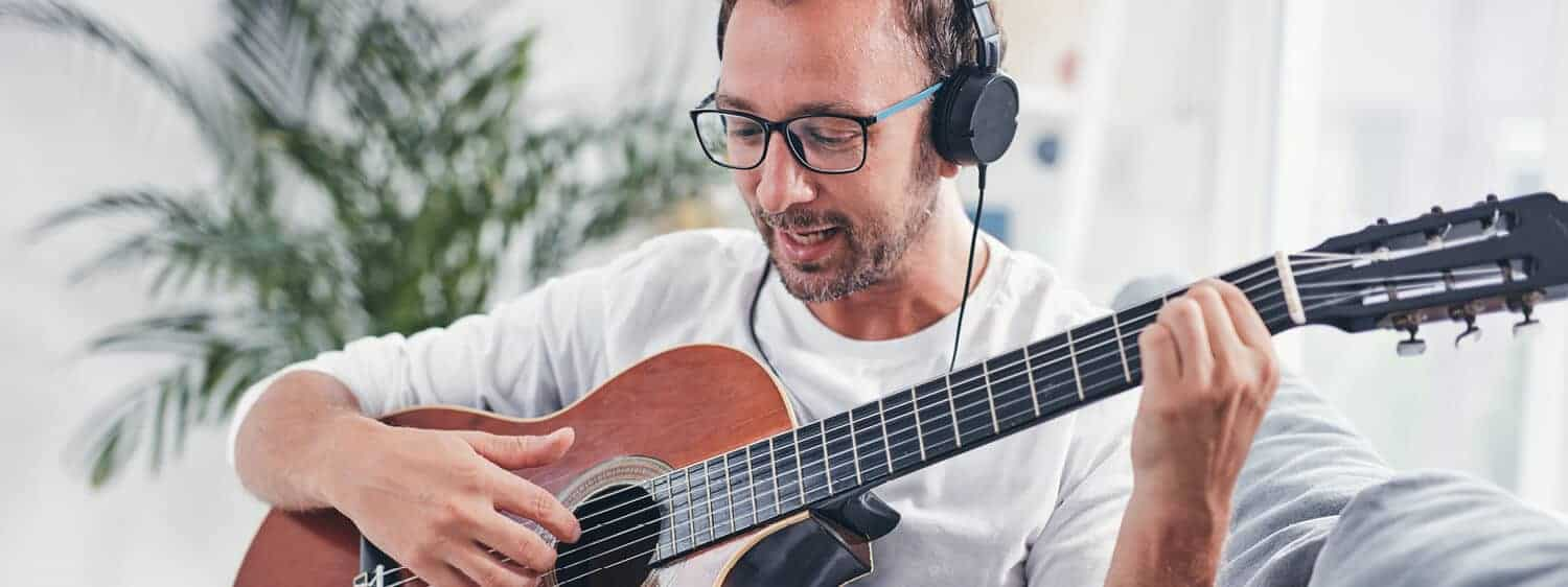 A person strumming a guitar: Be equipped for music leadership.
