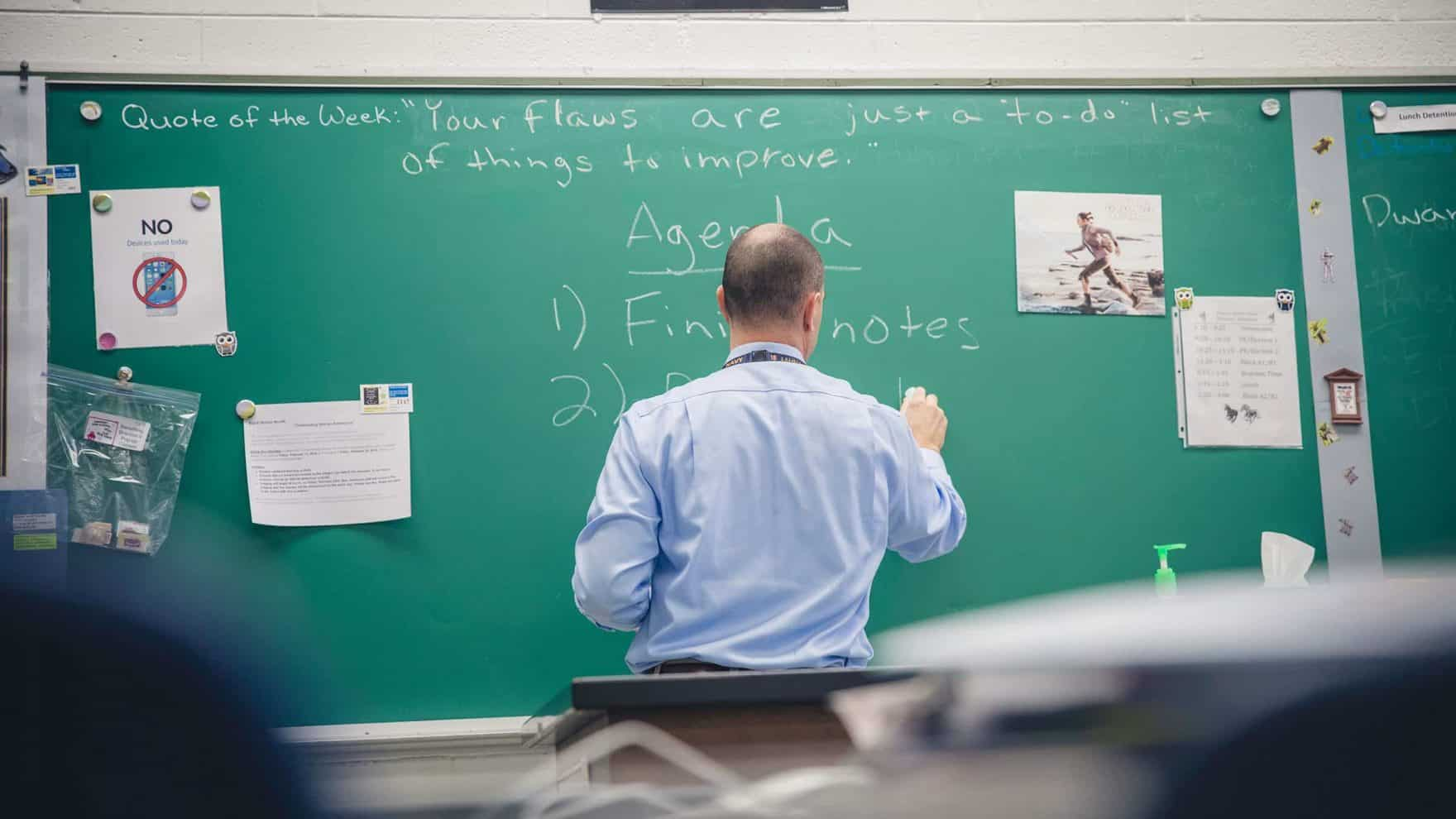 A Regent alumnus teaches in his classroom: Learn how to become a teacher.