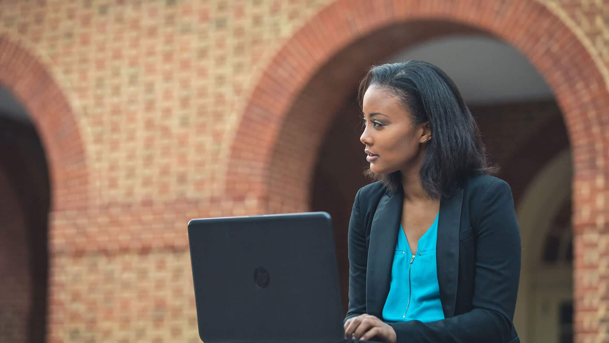 A Regent student with her laptop: Our online bachelor's programs have been ranked as number 1 in Virginia.