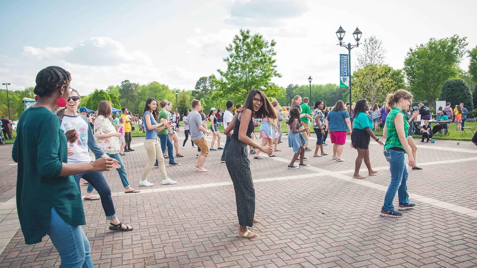 Students dance during an event at Regent University, Virginia Beach.
