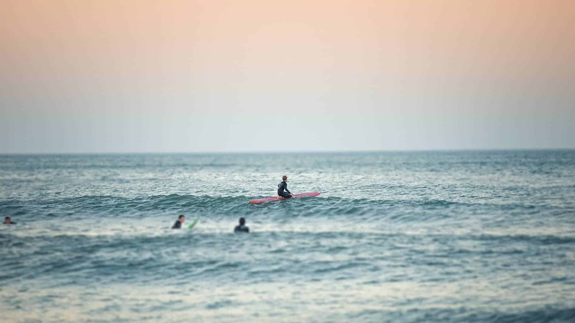 Students surfing in Virginia Beach, the beautiful city that Regent University calls home.