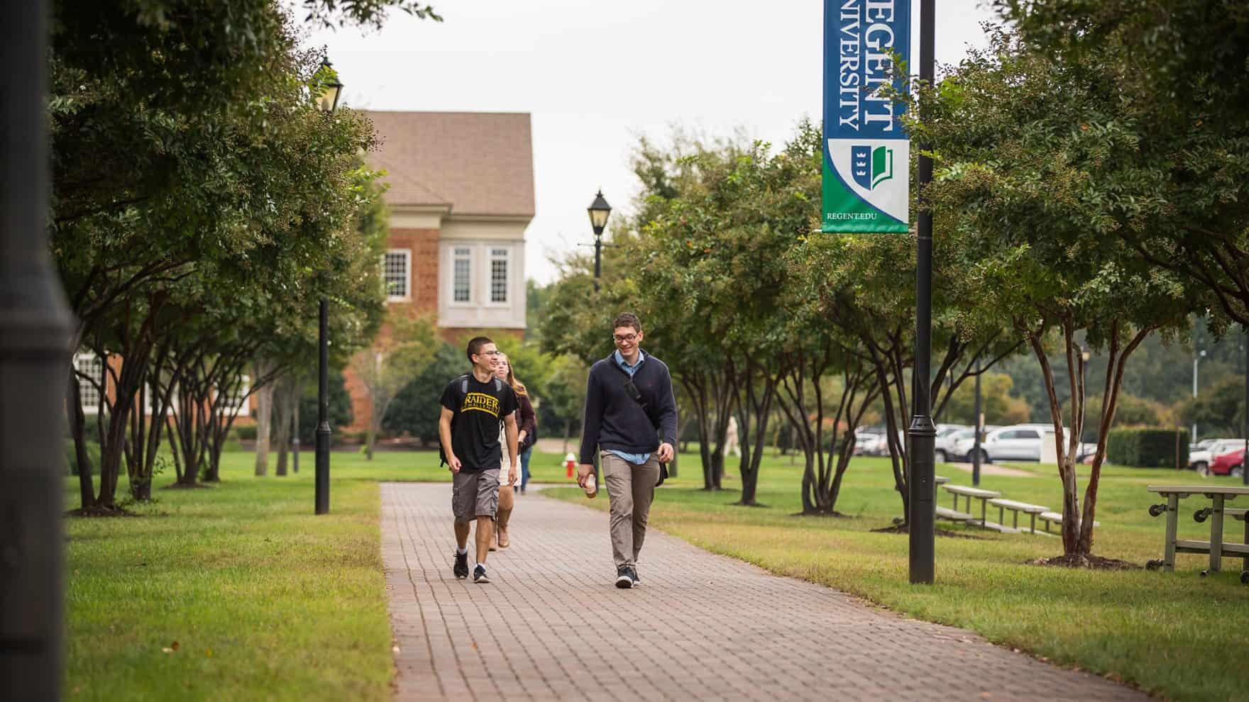 Students walk through Regent University, a Christian college in Virginia Beach.